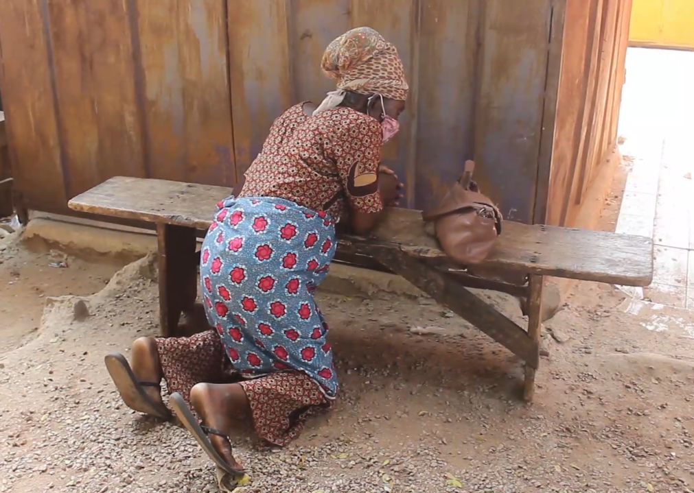 70-year-old Abena Animwa cannot sit because of cancerous wounds on her buttocks.