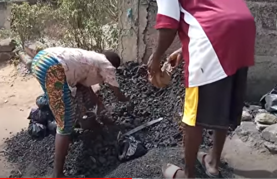 Ama Dansoa and her stammering son selling charcoal.